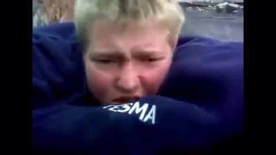 Blue shirt man falls