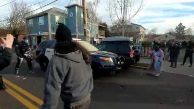Portland Police trying to serve an eviction get pushed back by angry residents.