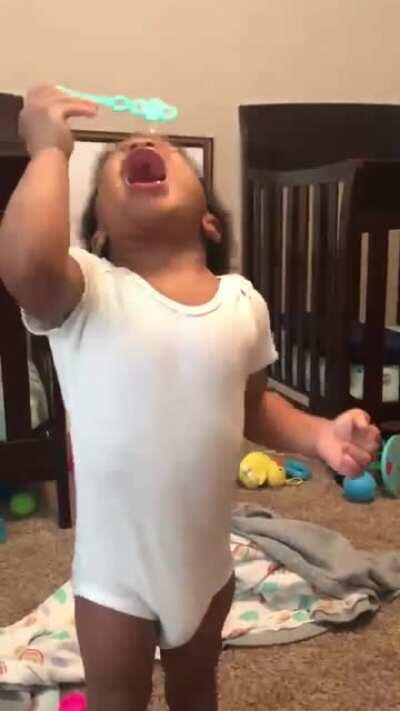 These twins trying to blow bubbles for the first time