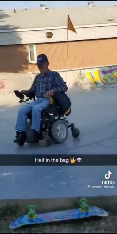 Old drunk man on his scooter sending it at the skatepark