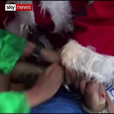 Police officers dressed as Santa Claus and an elf arrested an alleged drug dealer during an operation in the Peruvian capital Lima. This shit funny ass hell lmao