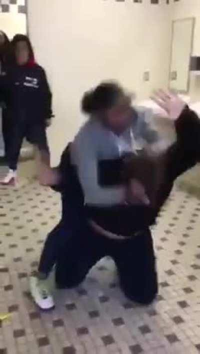 A girl asks bully to move 3 times, a fight ensues.