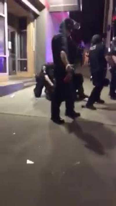 Seattle Police brutally beating restrained protestors