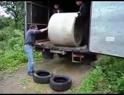 WCGW unloading a concrete pipe with tires