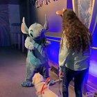 'Ezra' a service dog gets a well deserved break to go to meet her favorite character Stitch
