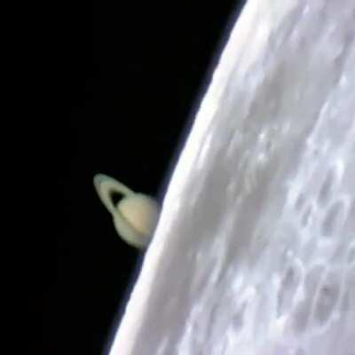 Incredible footage of Saturn rising from behind the Moon during a lunar occultation, captured from a ground-based telescope.