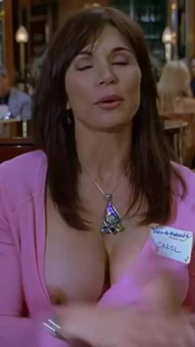 Kimberly Page's big titty pops out and her top gets caught on her hard nipple in