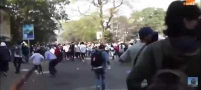 Military police in Myanmar fire live rounds at peaceful protestors.