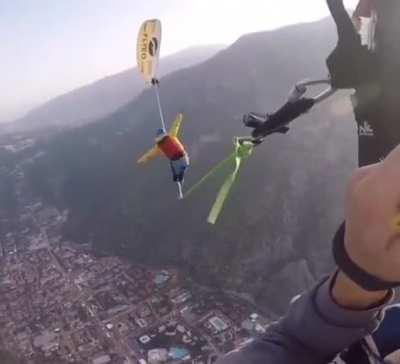 it is difficult to say whether he managed to open the parachute or not