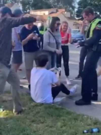 Cop starts giving him a drinking ticket, so everybody starts giving him money to pay it off.