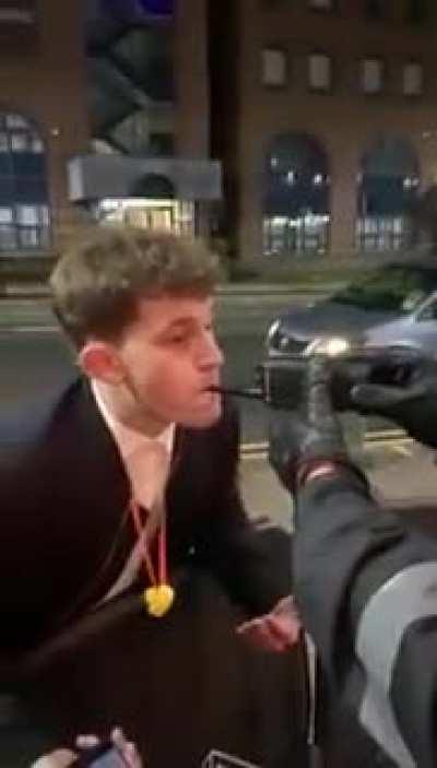 Guy blows into a radio thinking it's a breathalyzer