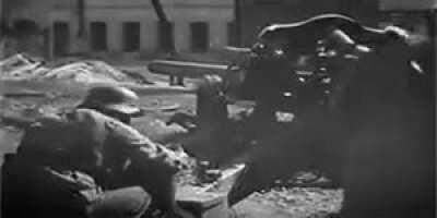 Waffen SS soldiers fire a 10.5 leFH 18 howitzer at point blank range during street fighting in Kharkov, 1943.