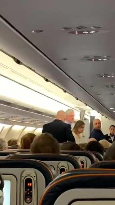 Man demands handshake on airplane