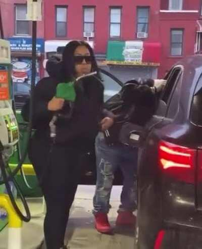 She's doing a hand job to a fuel pipe?
