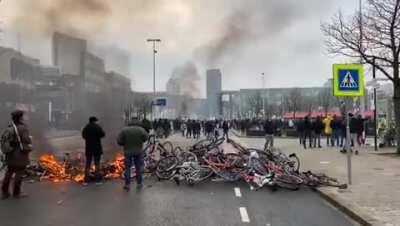 Anti-lockdown rioters in Eindhoven, the Netherlands build a barricade out of... bikes