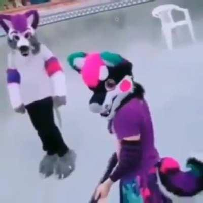 Imagine going to a public pool and seeing a fursuiter with a gun