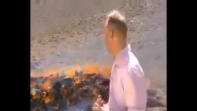 BBC reporter struggles to maintain composure after inhaling fumes from burning narcotics.