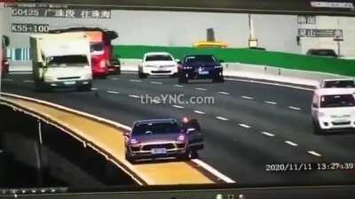 Moron in China leaves his car jack on the road which causes a massive accident.
