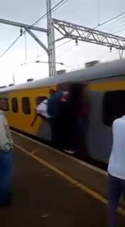 WCGW standing close to a packed train