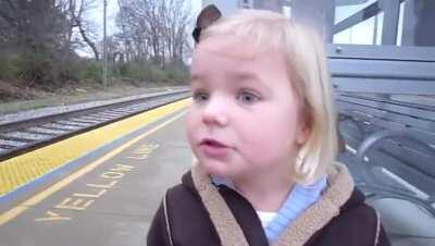 A little girl seeing a train for the first time!