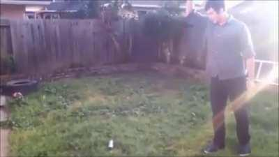 Throwing a knife into a spray paint can