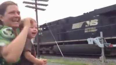 Engineer's Son Realizes His Dad is Driving Passing Train