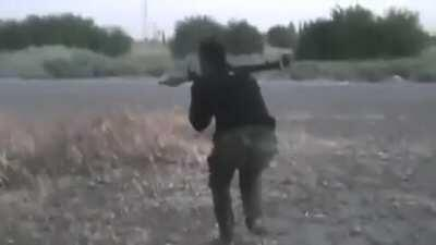 FSA fighter shoots an RPG at SAA tank, and then takes immediate return fire. Deir ez-Zor, Syria. 10-4-2012