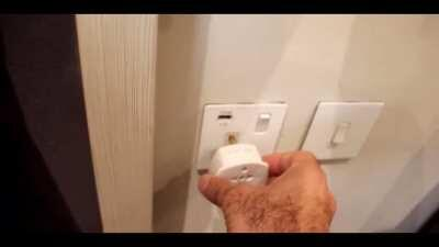 Putting faulty plug in socket