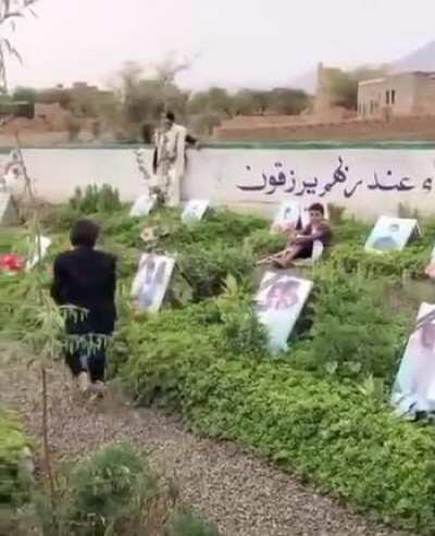 Yemeni child is kissing the photos of his siblings taken from him in this unjustifiable and immoral war.