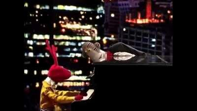 A puppet playing the piano