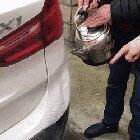 Fixing a car dent with hot water