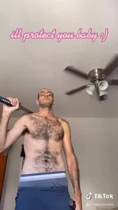 That amount of body hair. The katana gives it the touch.