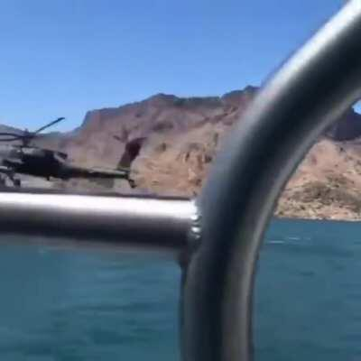 Being overtaken by a helicopter while you're boating is not common..