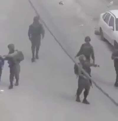 WATCH: (O_O) isreali occupation soldiers use a Palestinian Child as their human shield. Then the occupiers throw tear gas bombs into the Palestinian Houses.