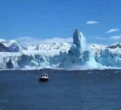An iceberg rising and forming a huge pillar after falling