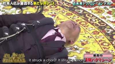 Matsumoto tries the hug machine.