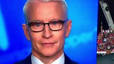 Anderson Cooper tries valiantly to keep a straight face as 'Macho Man' by The Village People plays at Trump rally
