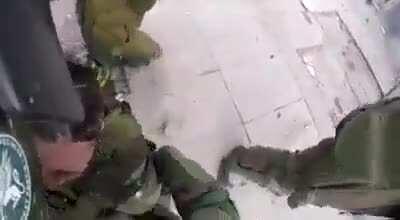 Riot cop hit with molotov