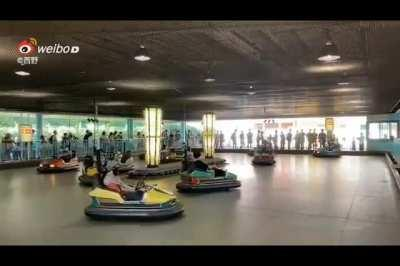 Japanese people in bumper cars