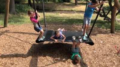 A child, a swing, a fullscorpion