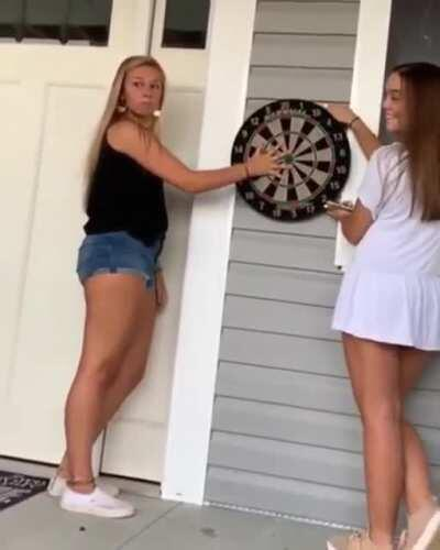 WCGW putting your hand on a dartboard