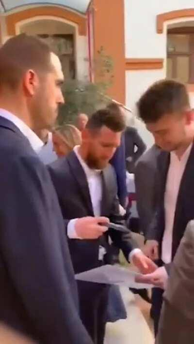 Finally getting a signature of his idol Lionel Messi!