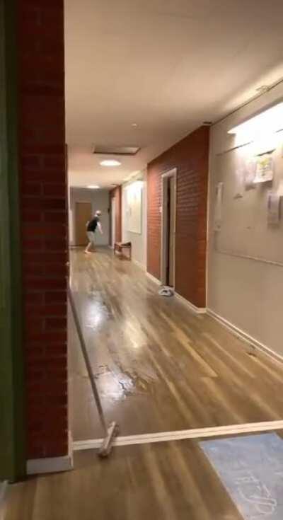 WCGW sliding through a hallway.
