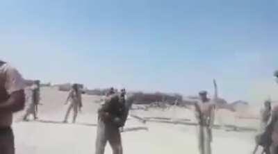 Pakistani paramilitary soldiers kill a suspected Taliban suicide bomber. [Not for the faint hearted]