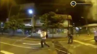 WCGW throwing a tear gas canister