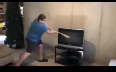 Ungrateful kid smashes tv with a bat