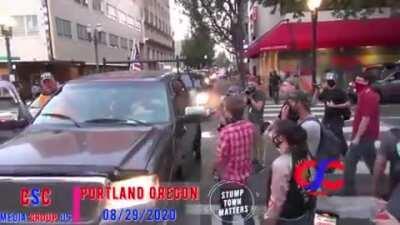 BLM Protestor Pretends Trump Cruise Ran Into him