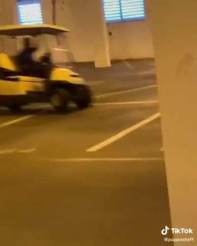 Racing a golf cart in an empty parking lot