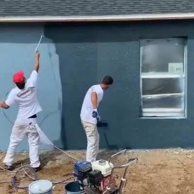 Spray painting a house