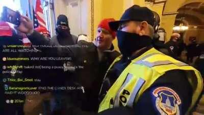 Police ofricer takes a selfie with a Trump supporter inside the US Capitol